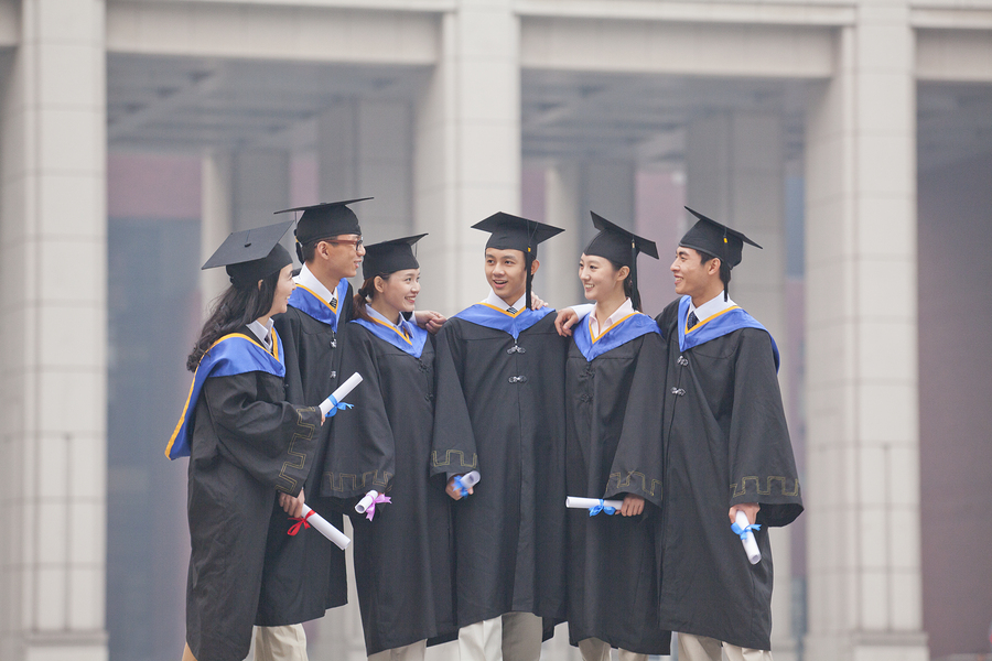 bigstock-Group-of-Graduate-Students-Sta-50561486