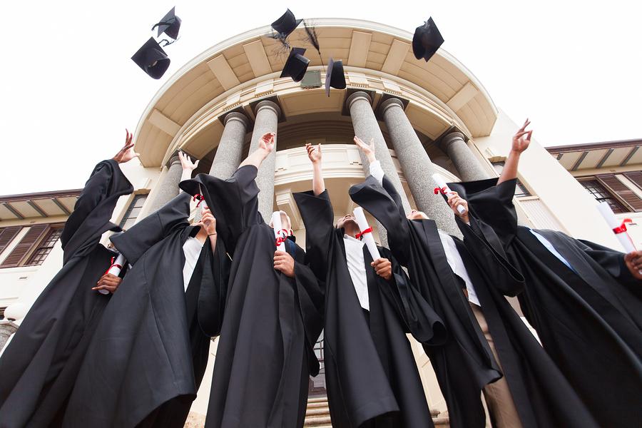 bigstock-group-of-happy-graduates-throw-58860062